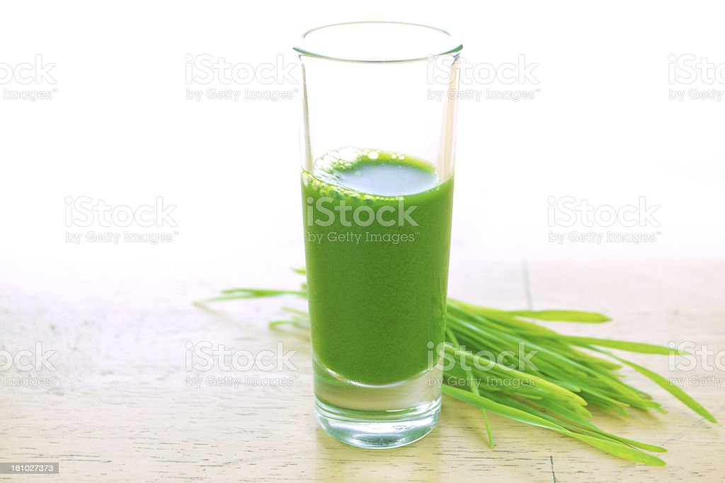 Wheatgrass in glass stock photo