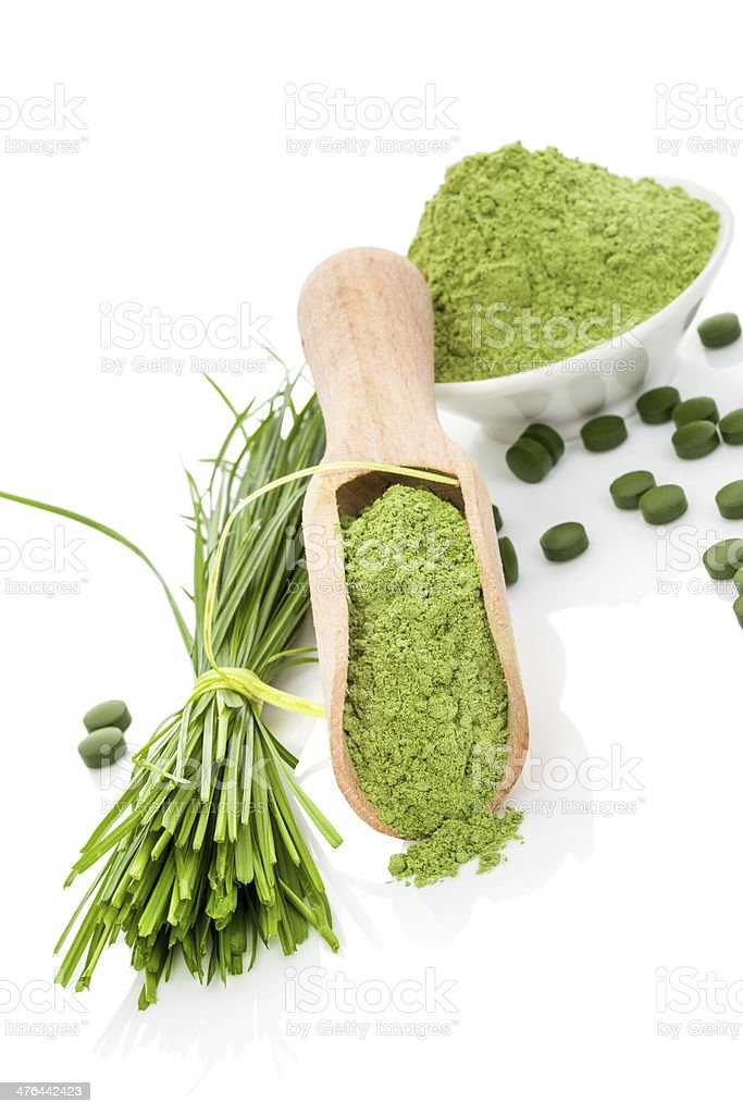 Wheatgrass powder and pills. Superfood. royalty-free stock photo
