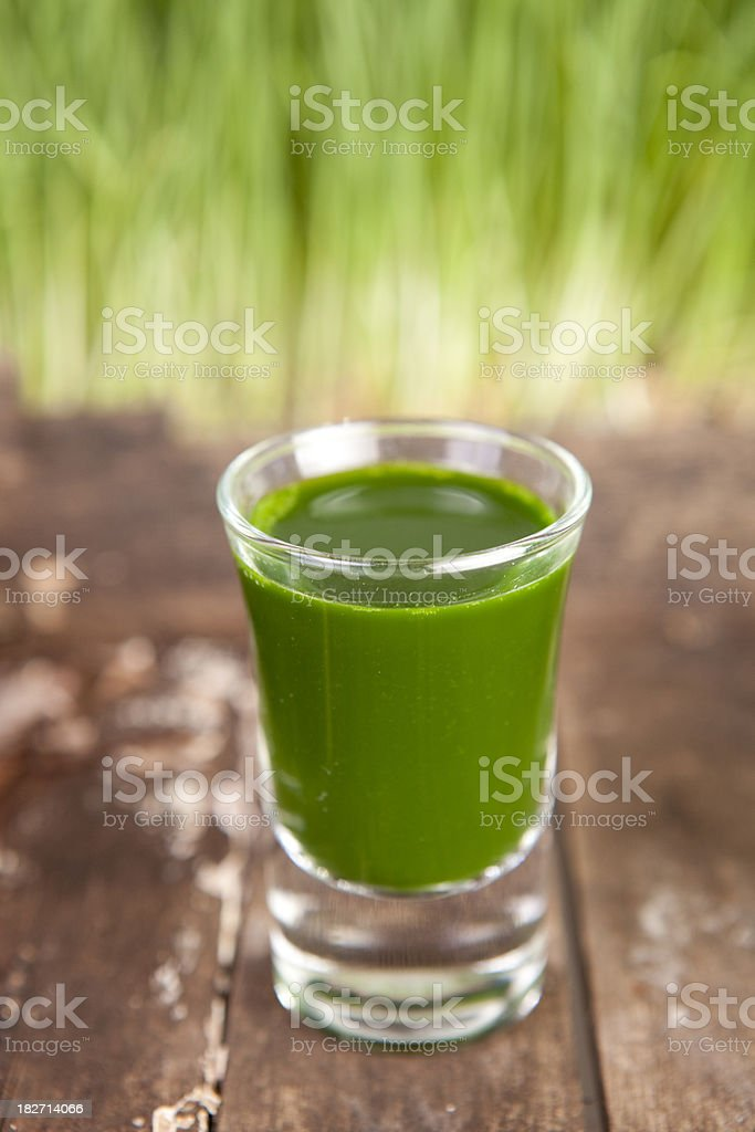 wheatgrass shot stock photo