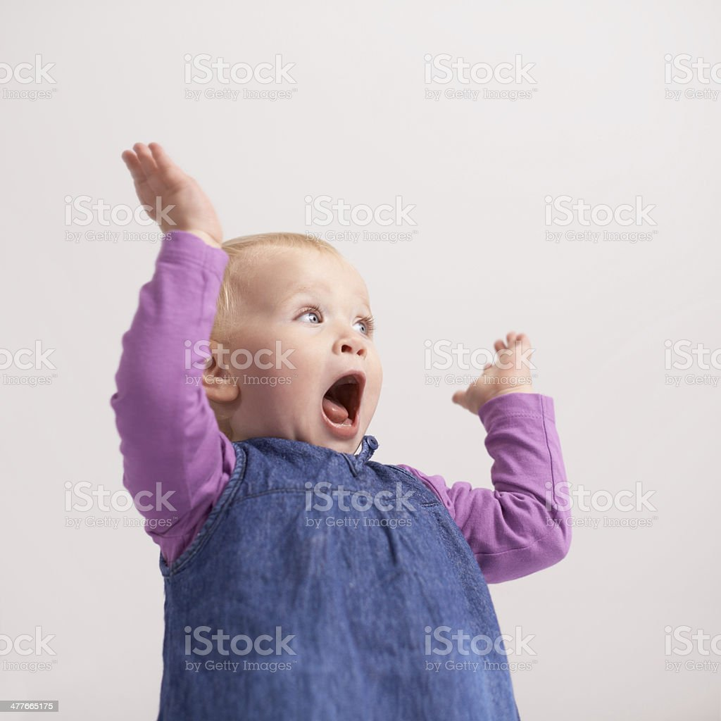 Wheee!!! She's having so much fun stock photo