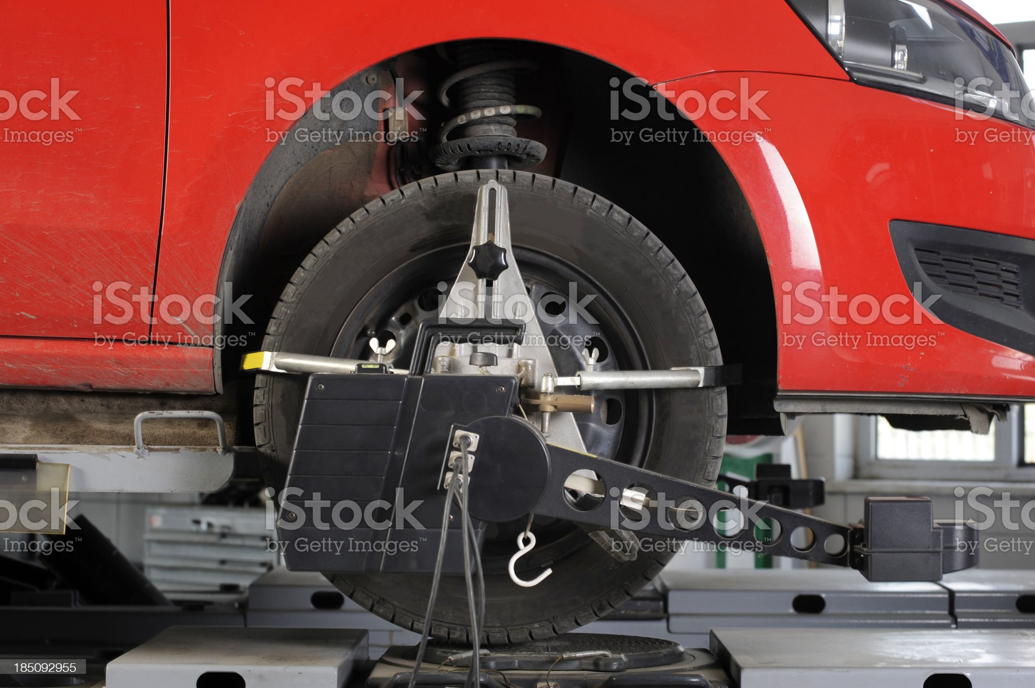 Wheel alignment and balancing with computer royalty-free stock photo