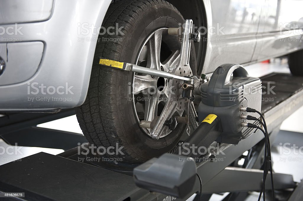 wheel alignment and balancing with computer stock photo
