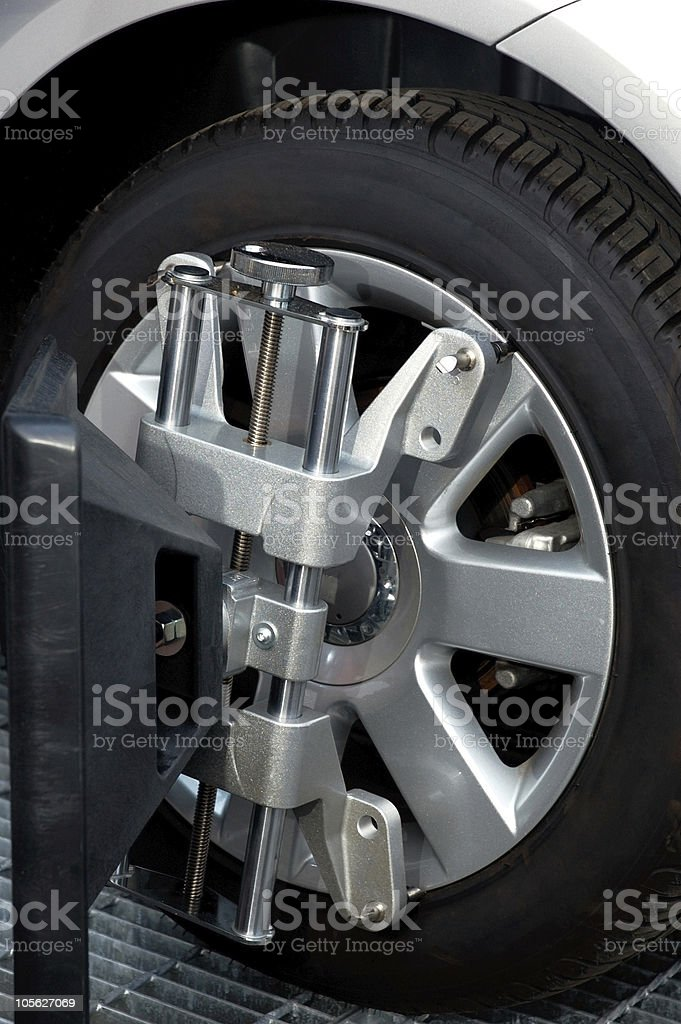 A wheel alignment machine clamp stock photo