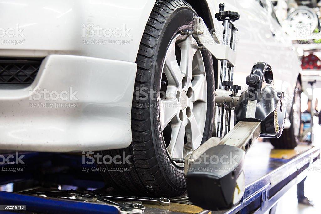 Wheel alignment of automobile stock photo