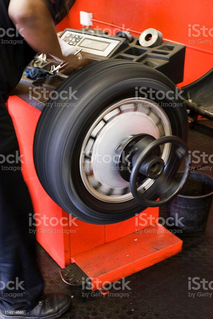 Wheel balancing (motion blur) royalty-free stock photo