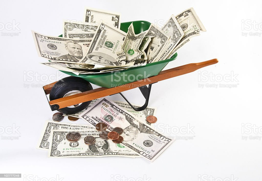 Wheel barrel filled with cash royalty-free stock photo