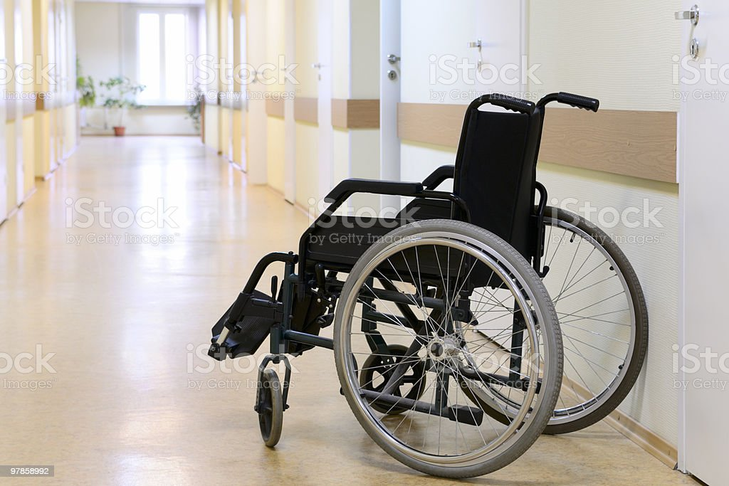 Wheel chair in the hospital corridor. stock photo
