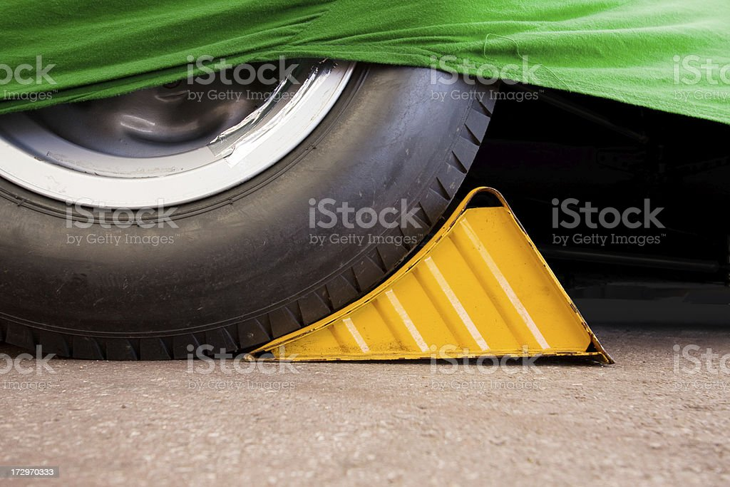 Wheel Chock Stored Vehicle Yellow stock photo