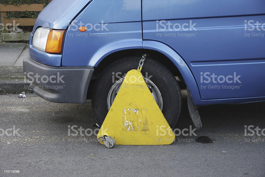 Wheel clamp yellow Denver boot on blue van stock photo