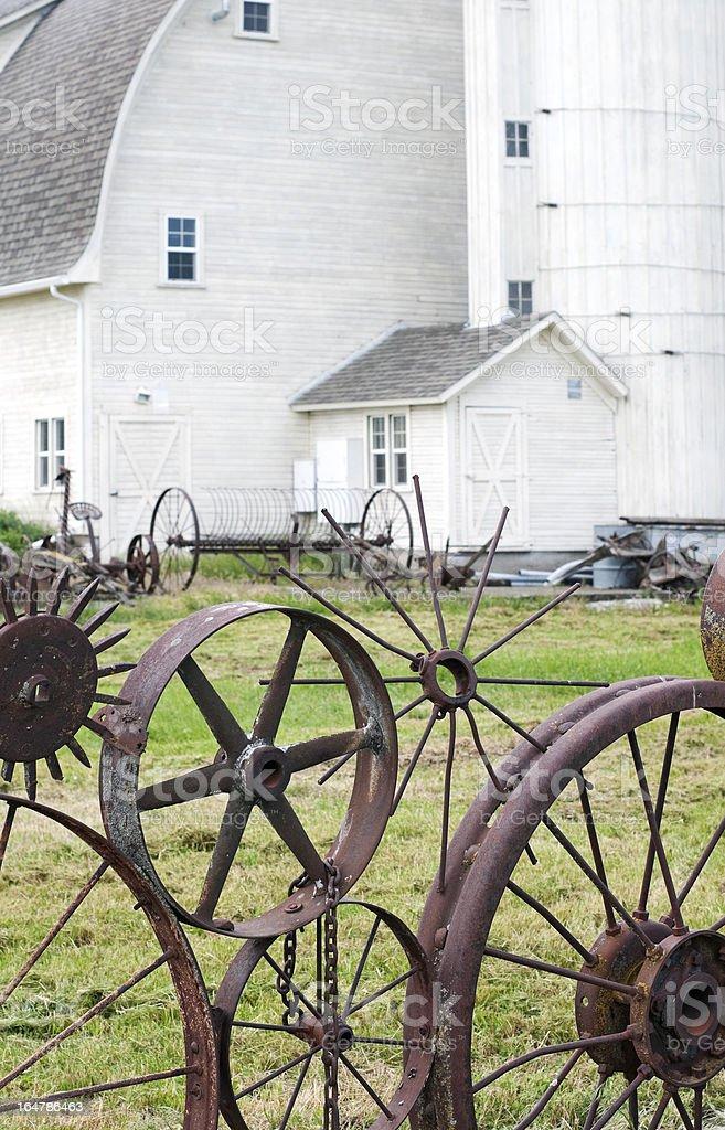 Wheel fence and barn royalty-free stock photo