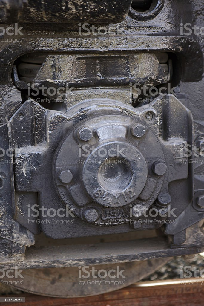 Wheel hub of train engine on track stock photo