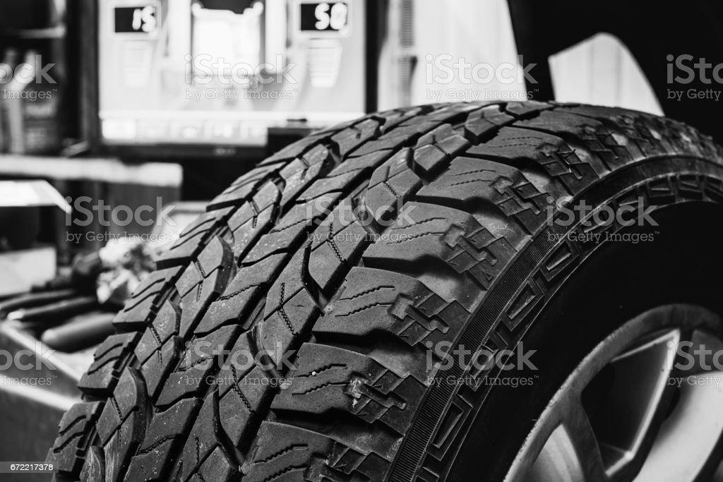 Wheel in balancing tire changer stock photo