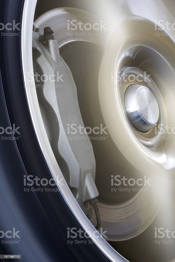 Wheel in motion stock photo