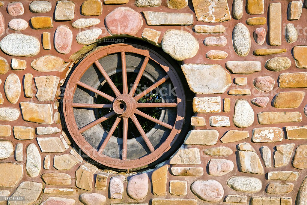 Wheel in Stone Fence Poland royalty-free stock photo