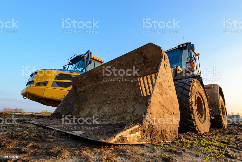 Wheel loader and Articulated hauler close up stock photo