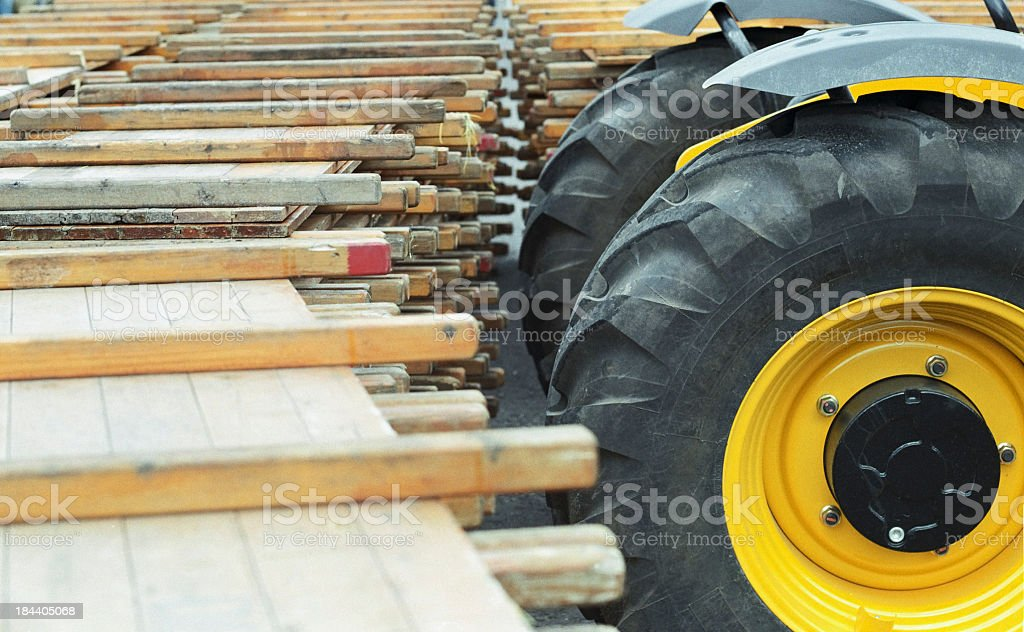 Wheel loader and beams - Construction site and equipment stock photo