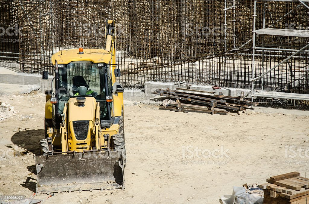 Wheel loader at earthmoving works stock photo