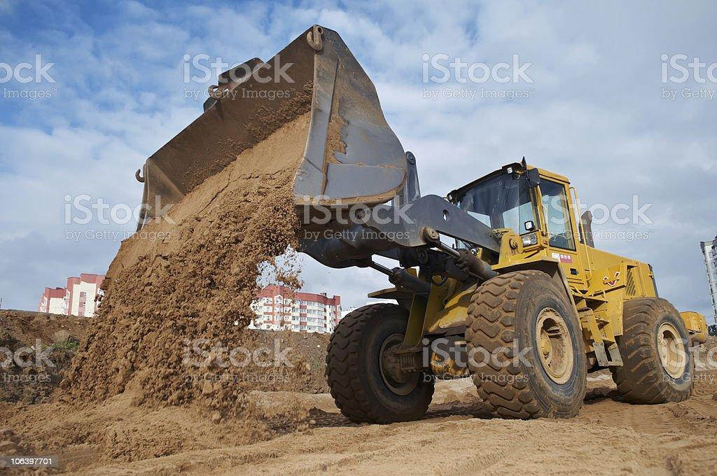 wheel loader at eathmoving works stock photo