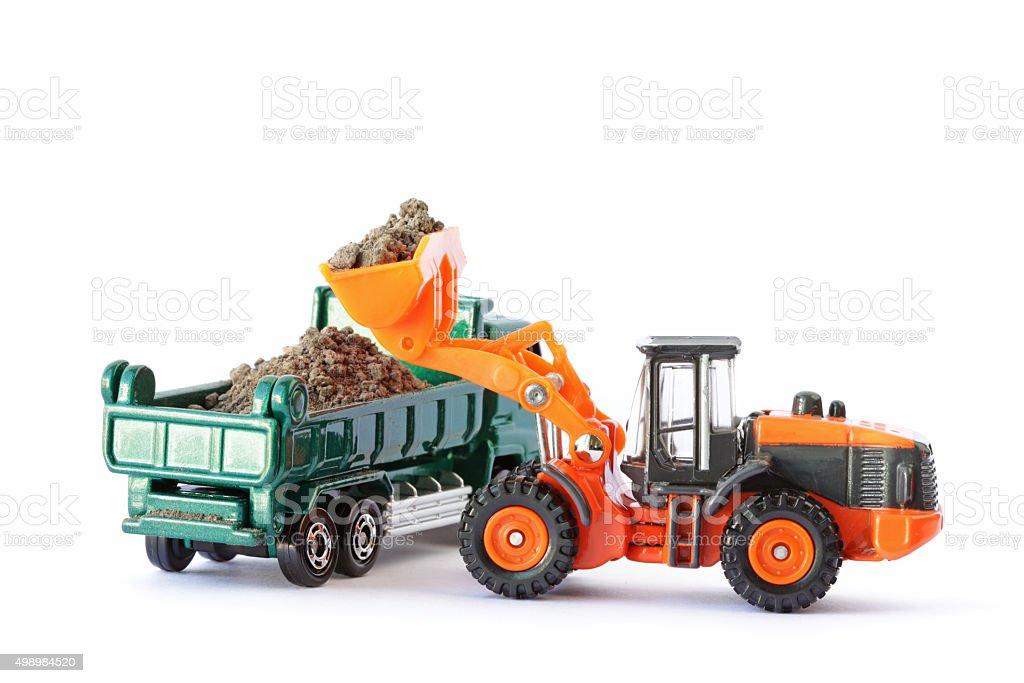 Wheel Loader Loading Soil on Dump Truck stock photo