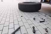 Wheel lying on the street, mount screw failure