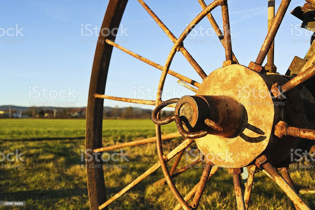 wheel of an old Tedder stock photo