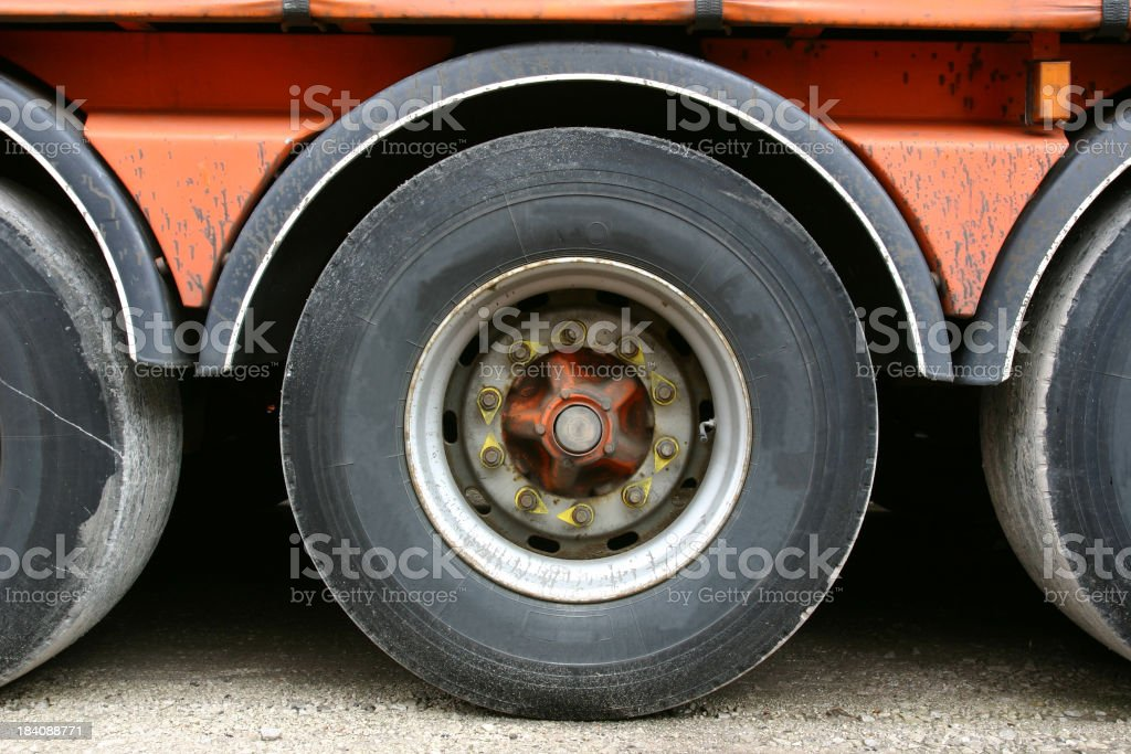 wheel of articulated truck and trailers royalty-free stock photo