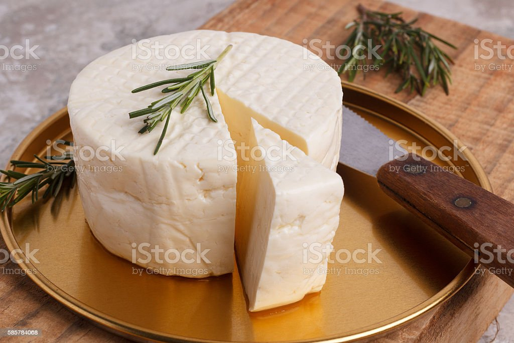 Wheel of brazilian traditional cheese Minas stock photo
