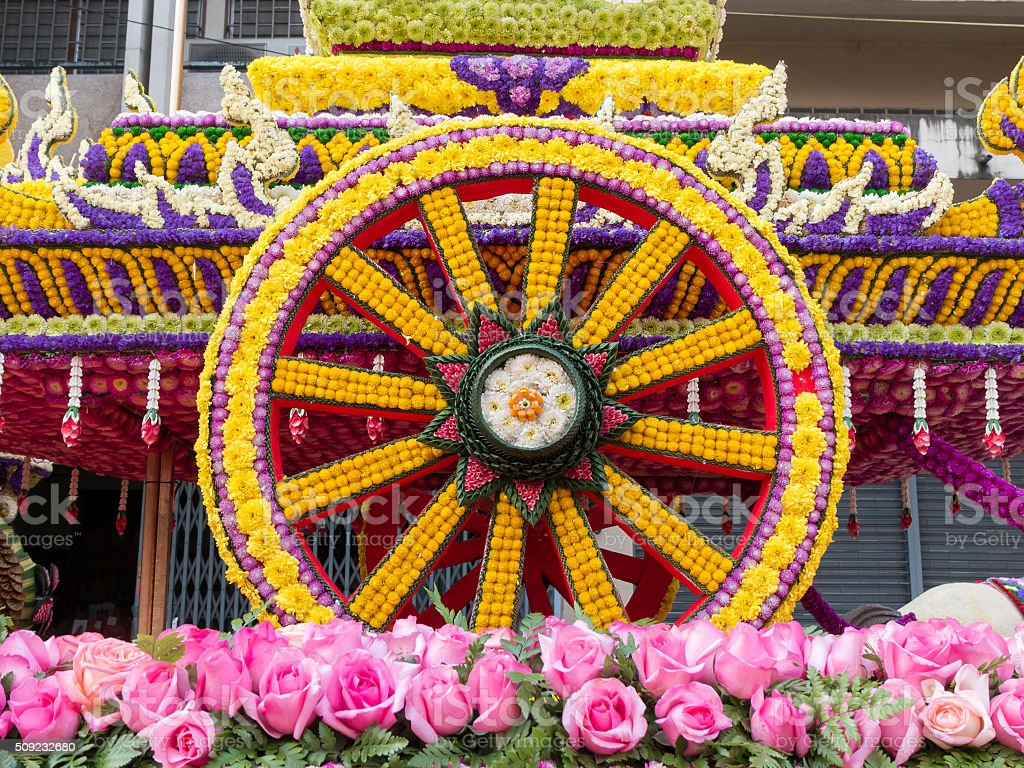 Wheel of cart is made from flowers (Flower Festival, Thailand) stock photo