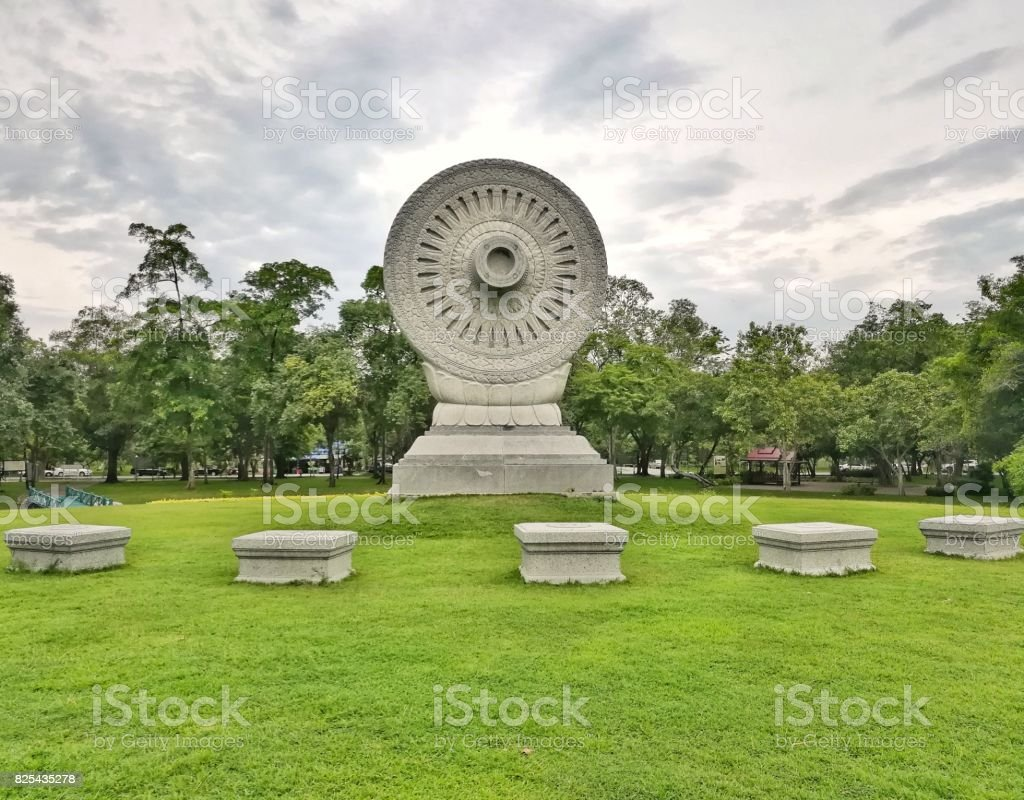 Wheel of Dhamma or Wheel of Law in public park at Phutthamonthon, Nakhon Phrathom, Thailand stock photo