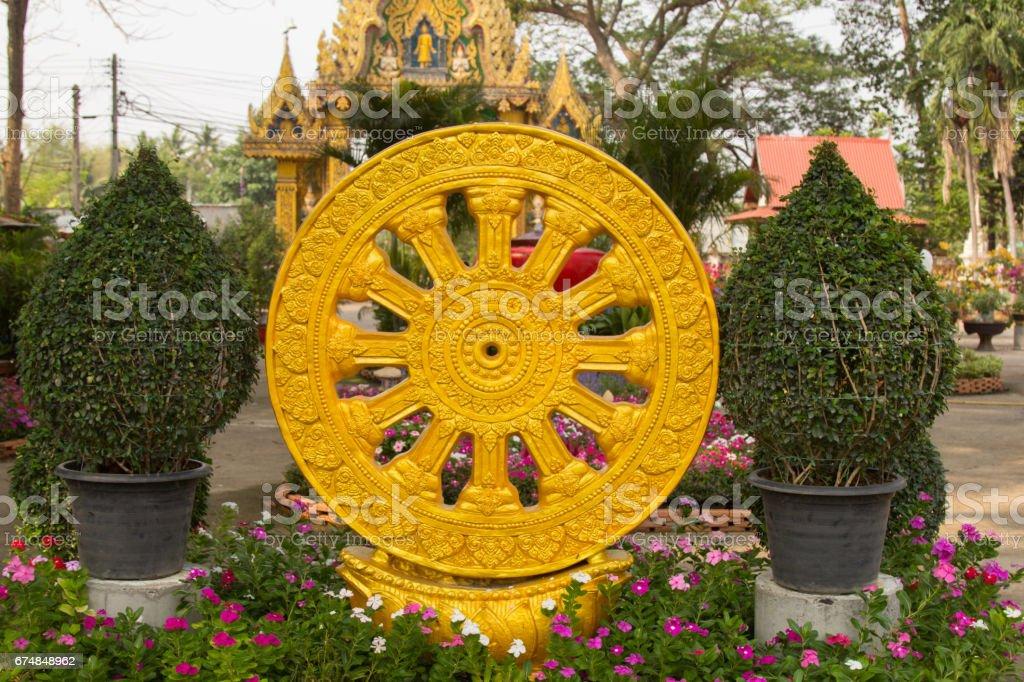 Wheel of Dharma texture or wheel of life stock photo