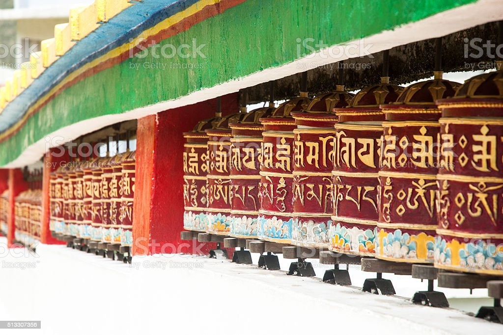 Wheel of pray in Tibetan temple stock photo