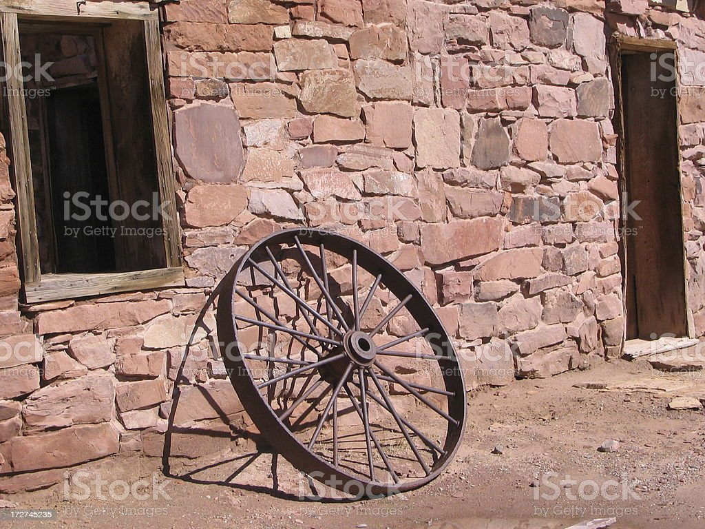 Wheel  Stone Building Antique royalty-free stock photo