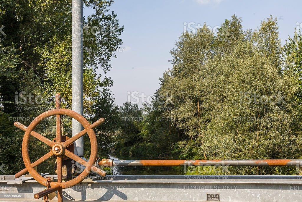Wheel to lift a sluice gate on the river Ticino stock photo