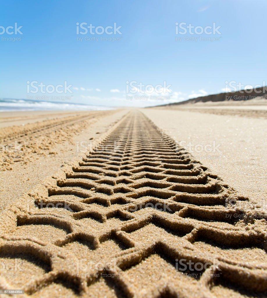 Wheel track on sand beach stock photo