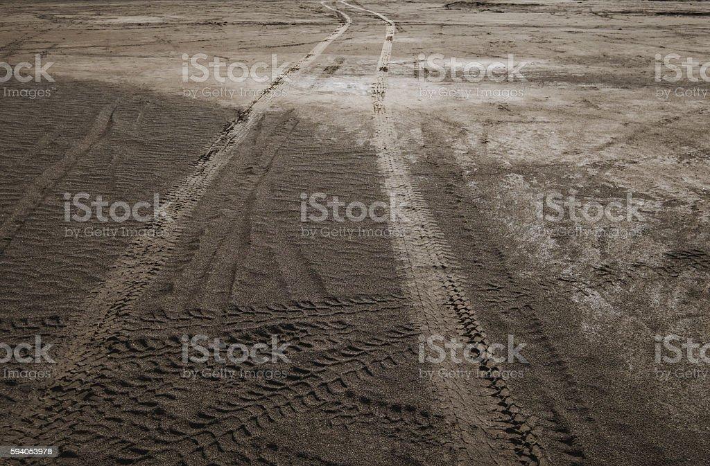 Wheel tracks on dirt road stock photo