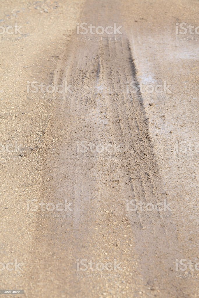 Wheel tracks on the road royalty-free stock photo