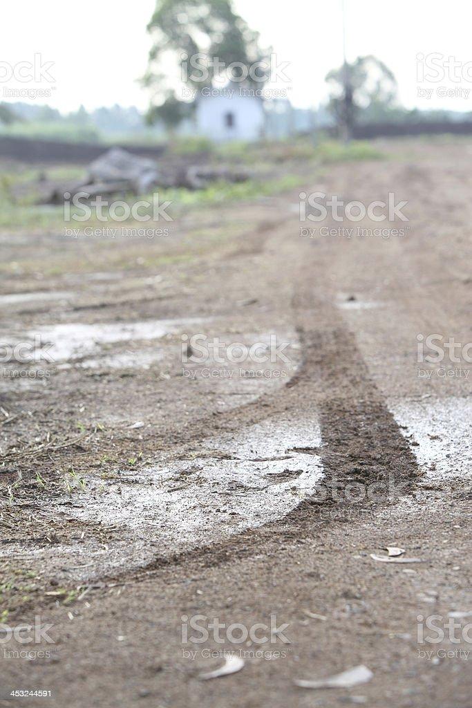 Wheel tracks on the road to garden royalty-free stock photo