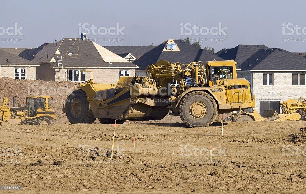 Wheel tractor-scraper on  suburban construction site stock photo