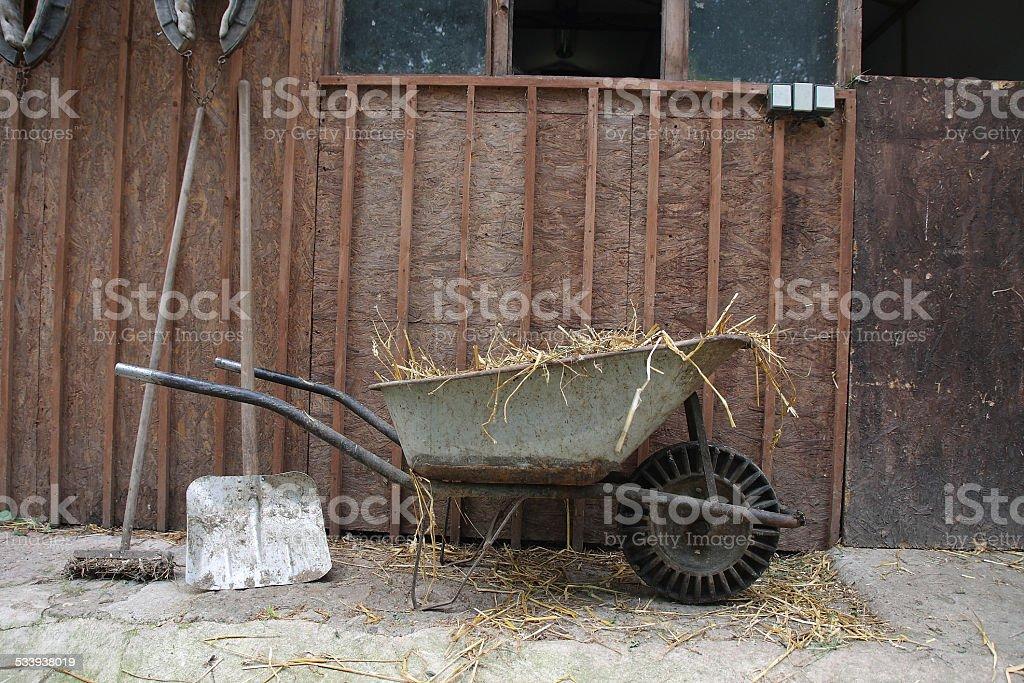 Wheelbarrow and farm tools at a farm stock photo