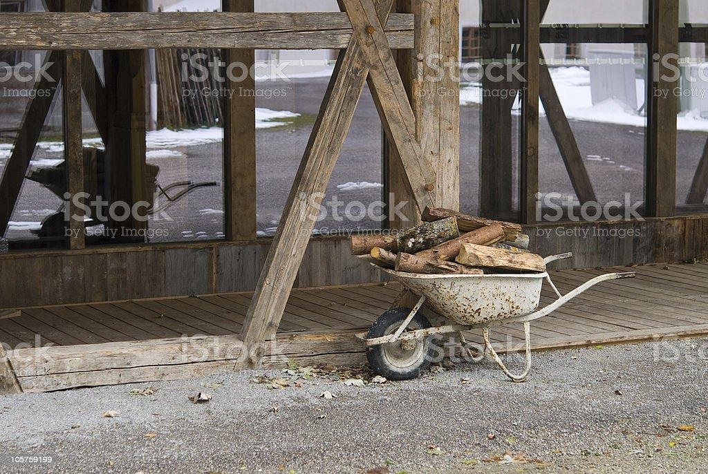 Wheelbarrow full of wood stock photo