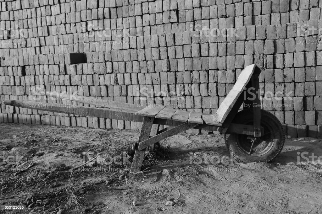 Wheelbarrow In Brick Factory stock photo