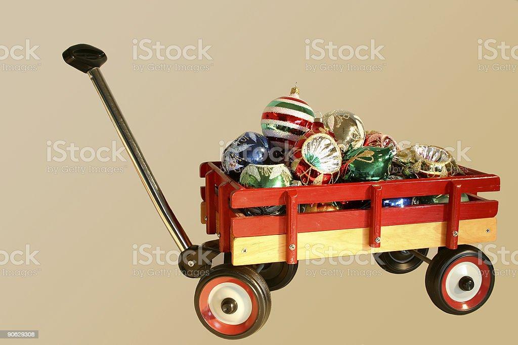 Wheelbarrow of glass ornaments stock photo