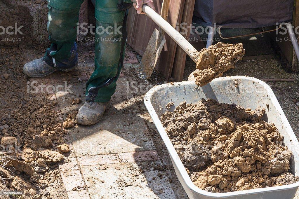 Wheelbarrow with earth excavation stock photo