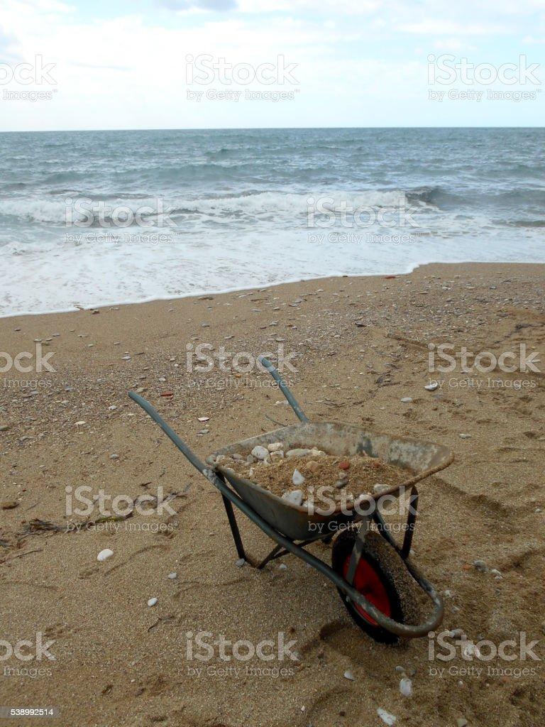 wheelbarrows full of sand and stones stock photo