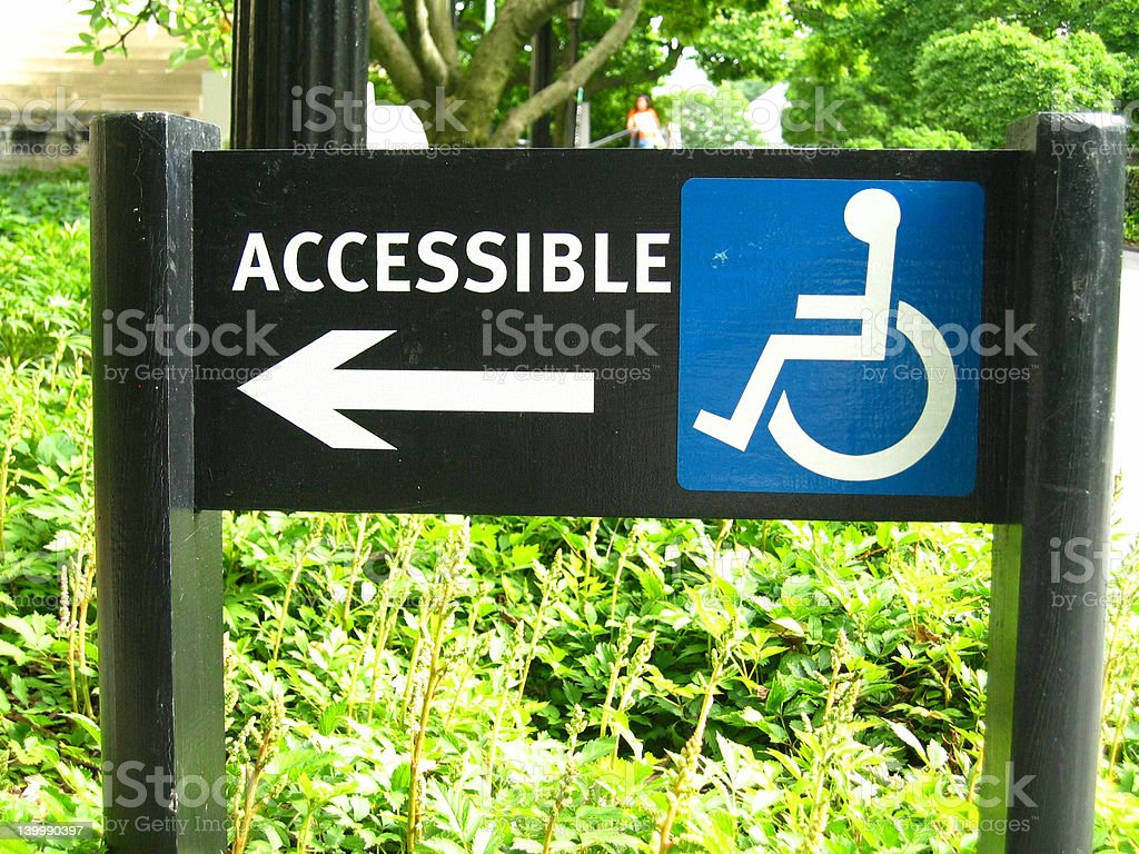 Wheelchair accessible sign pointing left royalty-free stock photo