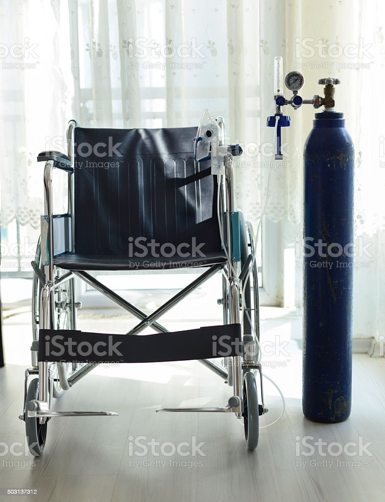 Wheelchair And Medical Oxygen Tube stock photo