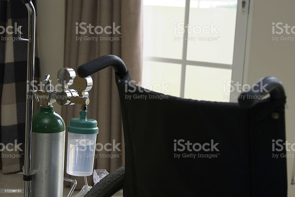 wheelchair and oxygen stock photo