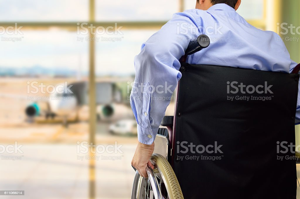 wheelchair businessman at airport stock photo