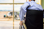 wheelchair businessman at airport