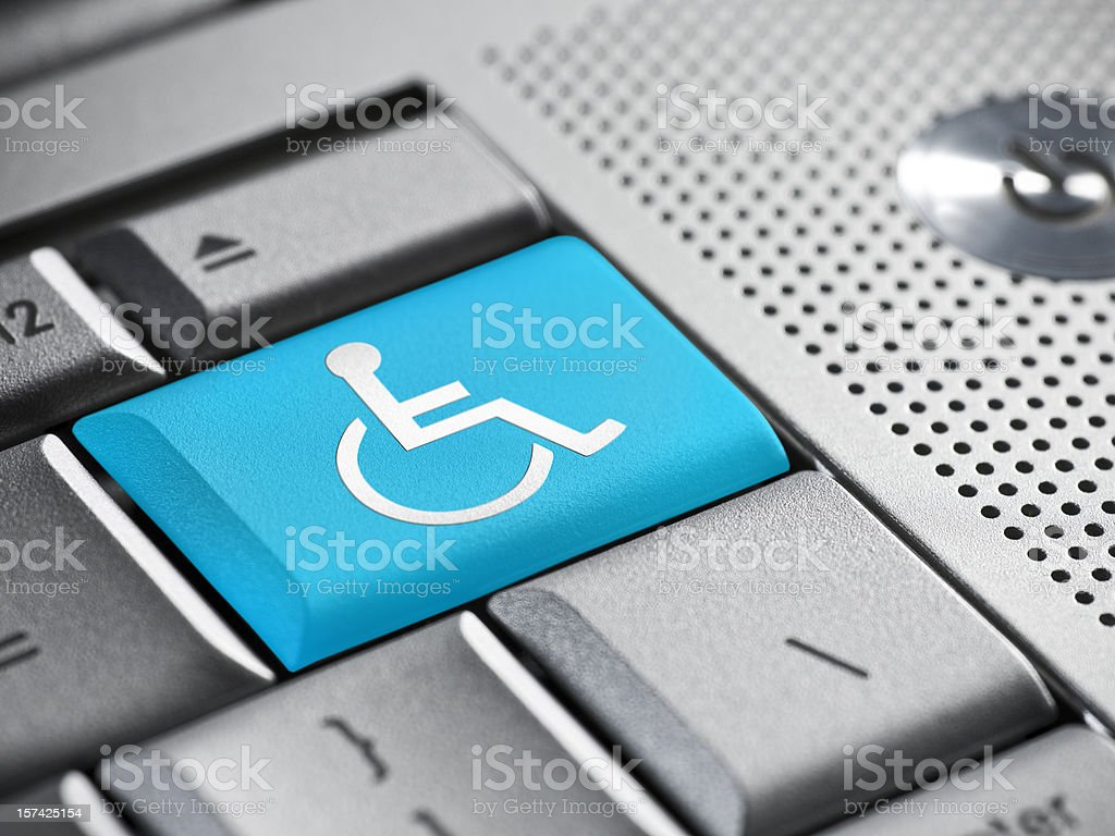 Wheelchair button on a laptop royalty-free stock photo